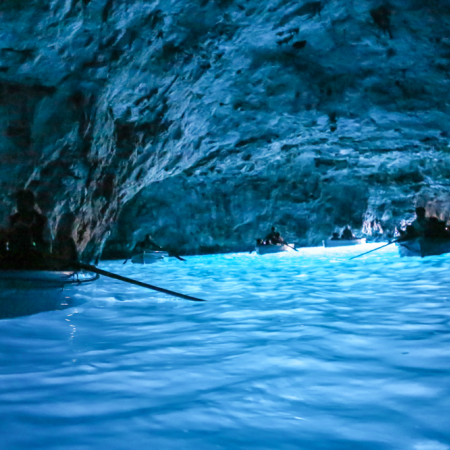 "Board a traditional ""luzzu"" and enter our cave network at Blue Grotto."