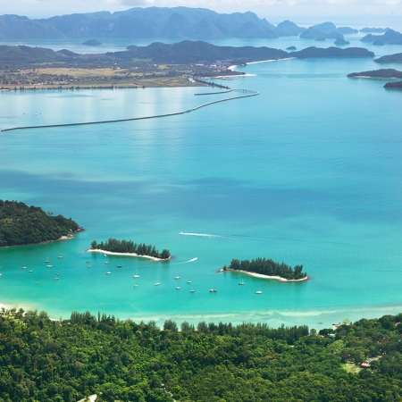 Admire the elegant Andaman Sea as the sun goes down. We decorate the beach to create a spectacular setting on Langkawi.