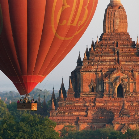 Enjoy a hot air balloon ride over the temples of Bagan at dawn.