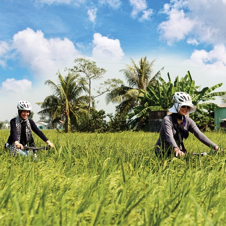 On a guided bicycle tour through a local village, delegates can see how the Vietnamese people make a living.