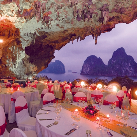Embark on a private cruise across Halong Bay and dine in a spectacular cave.