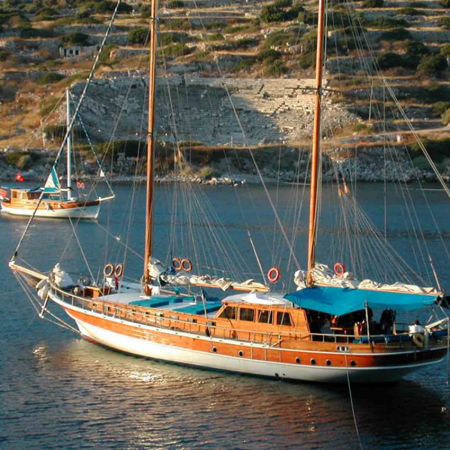Sailing through the unspoiled bays by private hand-made wooden yachts