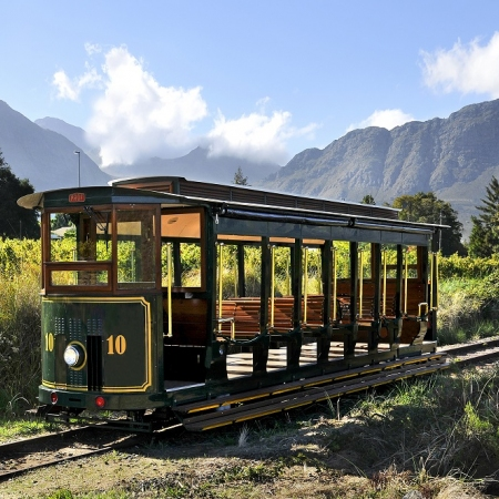 Journey with the Franschhoek Wine Tram hop-on hop-off tour through the Franschhoek Valley