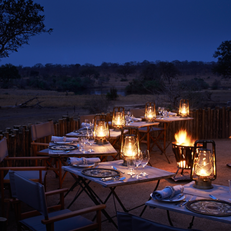 Enjoy traditional dinners in the bush while being entertained by African drummers